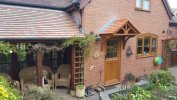 The Cheltenham Dual Pitched Tiled Over Door Canopy includes 2x Brackets